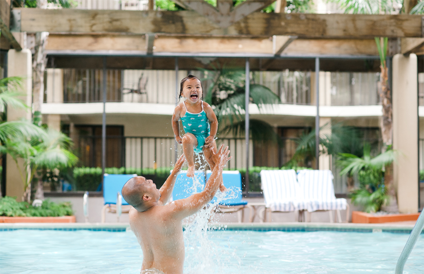 Kira Lauren Photography's shot of girl being thrown in air by dad in pool