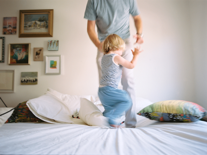 dancing on the bed by kauai photographer rachel thurston