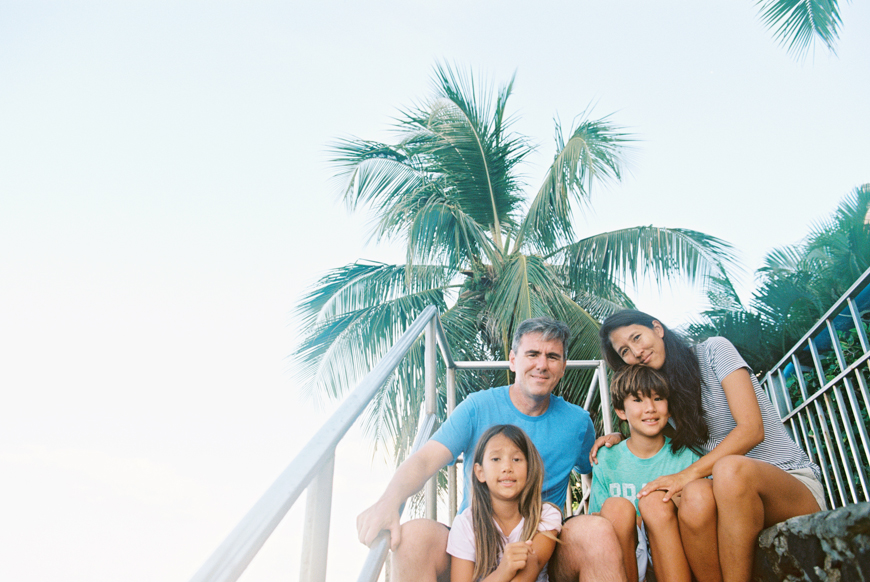 fun and joyful family photography images in ocean with surfboards in hawaii by maui photographer wendy laurel-13