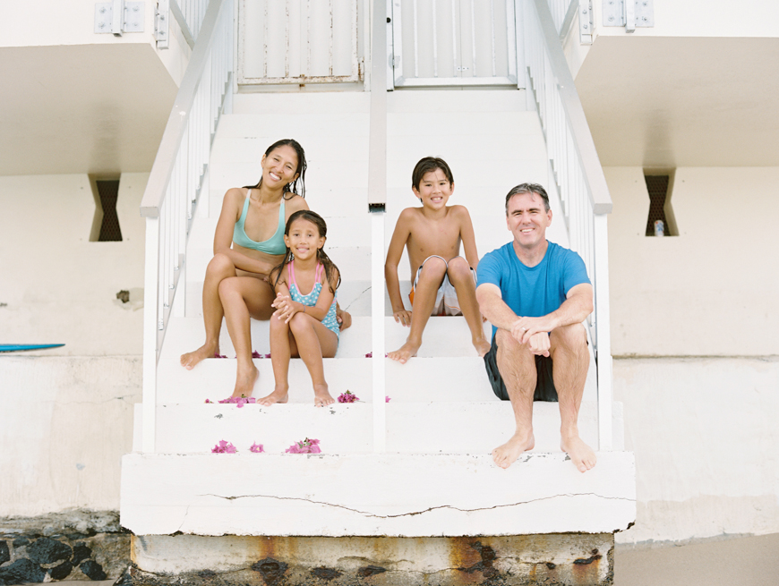 fun and joyful family photography images in ocean with surfboards in hawaii by maui photographer wendy laurel-28