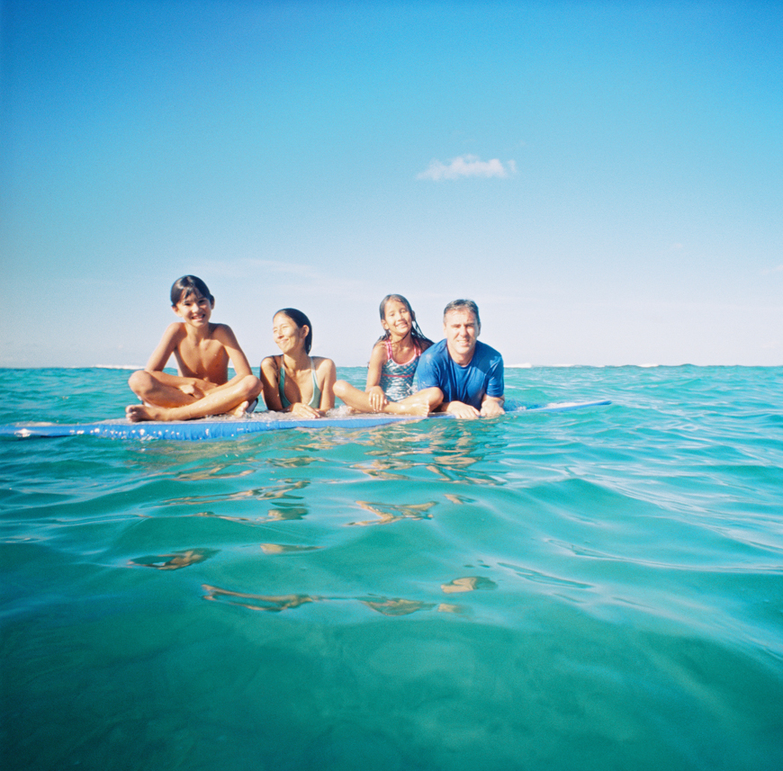 fun and joyful family photography images in ocean with surfboards in hawaii by maui photographer wendy laurel-3
