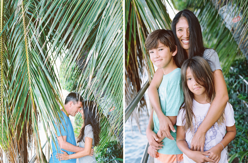fun and joyful family photography images in ocean with surfboards in hawaii by maui photographer wendy laurel-41