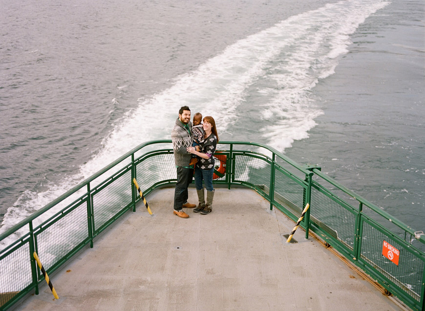 fun family portrait on deck of ferry by seattle photographer Catherine Abegg