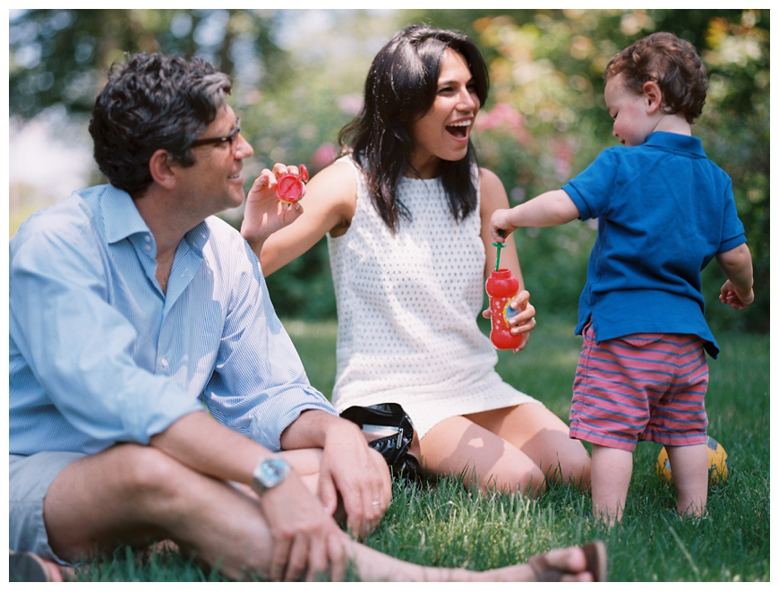 photo of family outside with bubbles by nj family photographer sarah day boodhoo