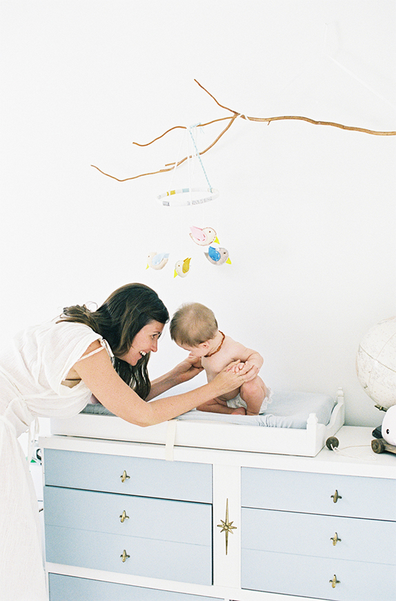 photo of photographer Jessica Lorren playing with daughter in her nursery by Mi Amore Foto