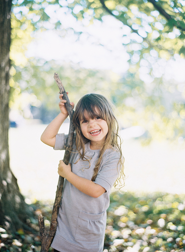 photograph of girl holding large stick by Miami film photographer Jessica Lorren