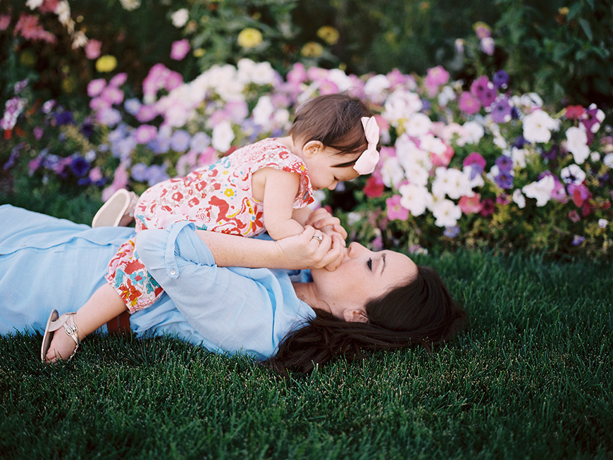 photographer brooke schultz's image of mom and baby laying in flowers