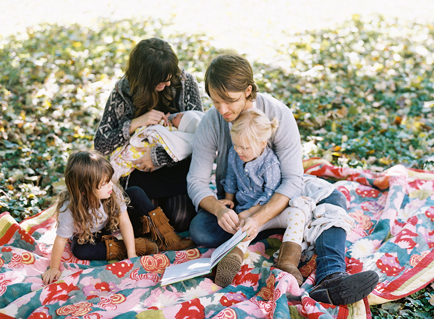 portrait of a family of 5 on a colorful quilt by Miami film photographer Jessica Lorren