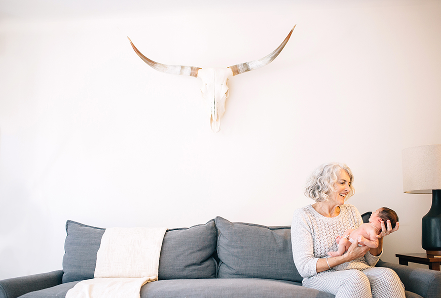 pretty image of grandma holding baby in modern apartment by photographer nicki sebastian