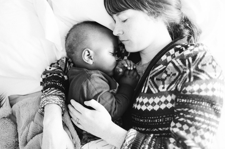 seattle photographer Catherine Abegg's lovely portrait of mom and son sleeping in black and white film