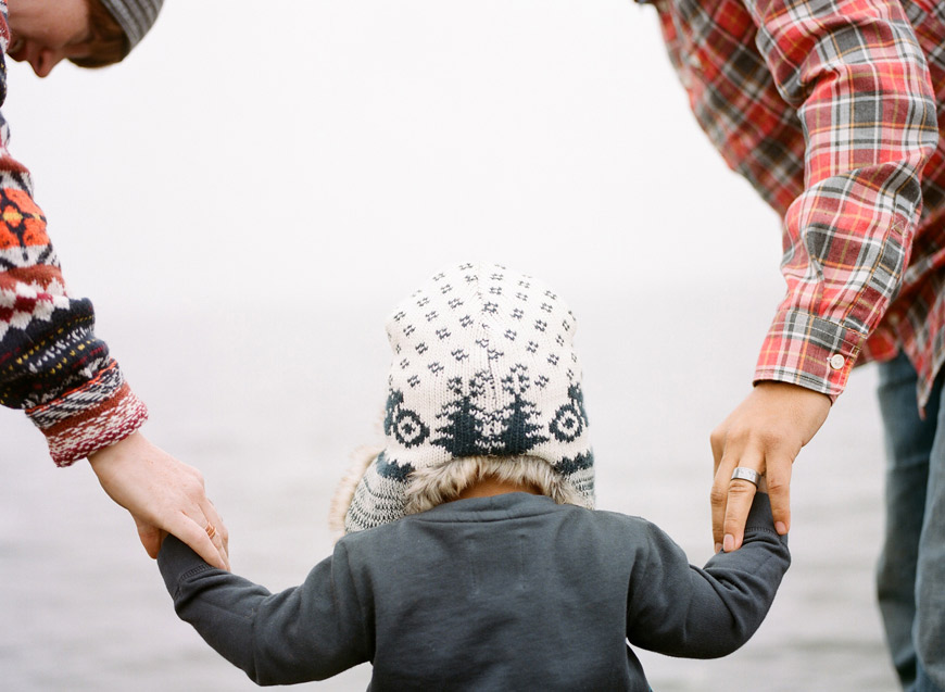 seattle photographer Catherine Abegg's photo of family holding hands in winter