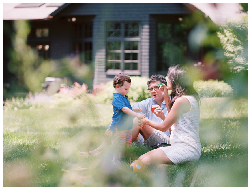 shot of family through leaves by nj family photographer sarah day boodhoo