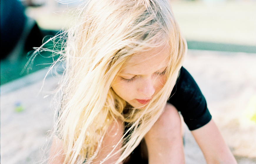 agi davis's film image of girl with blonde hair looking down in wind