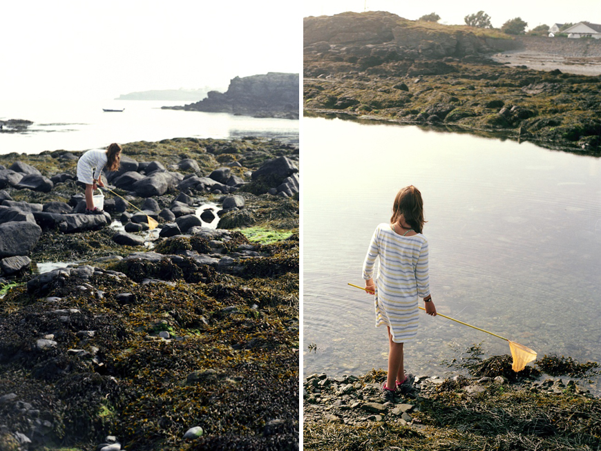 girl in striped tee dress with starfish net in north wales by lea jones