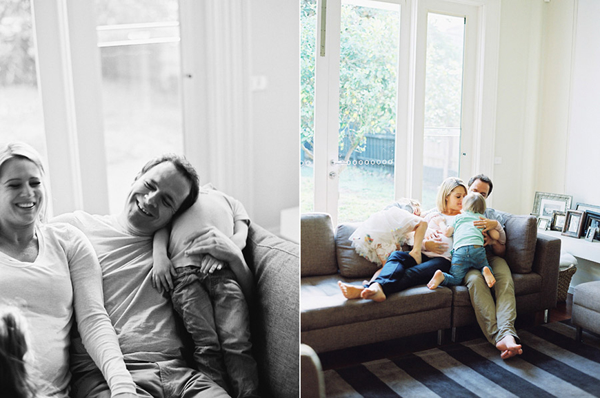 happy natural light portrait of family at home with striped rug by australia photographer sarah black