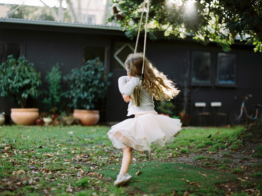 little girl on wooden swing film shot by australia photogapher sarah black