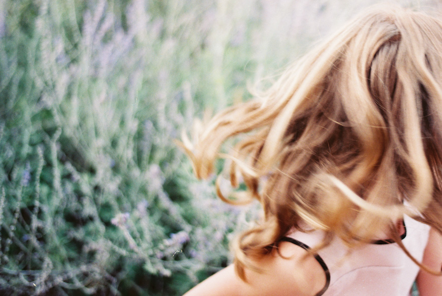 natalie ulrich's portrait of girl in light with hair swinging on film