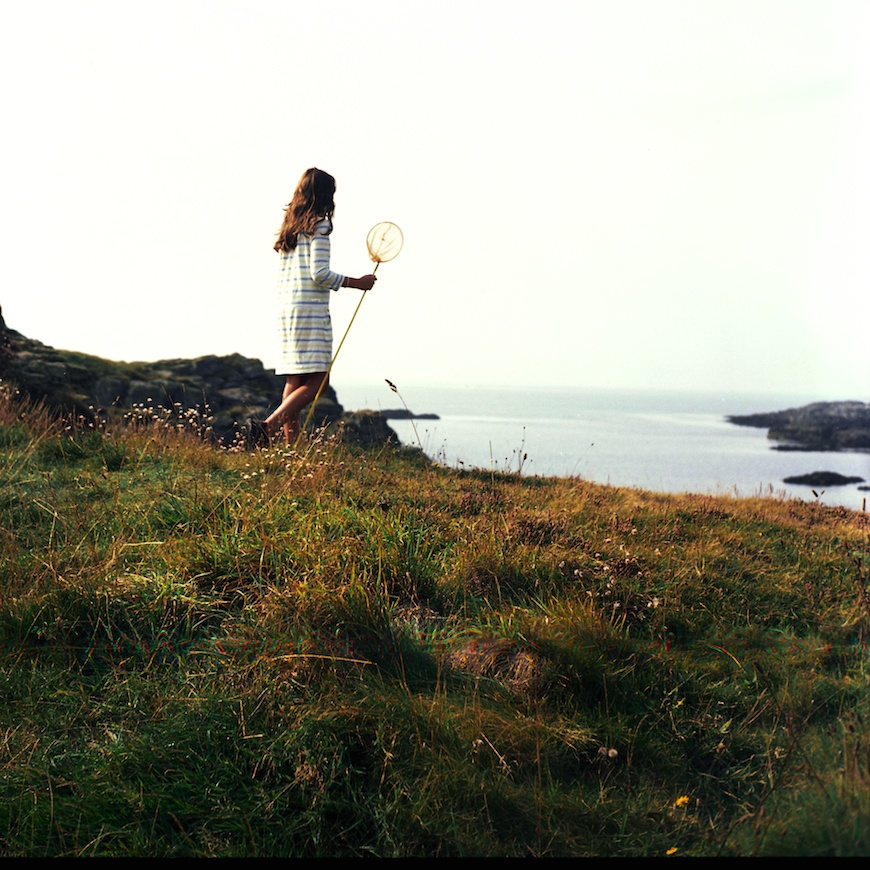 north wales photographer lea jones' photo of girl with net walking through coastal field