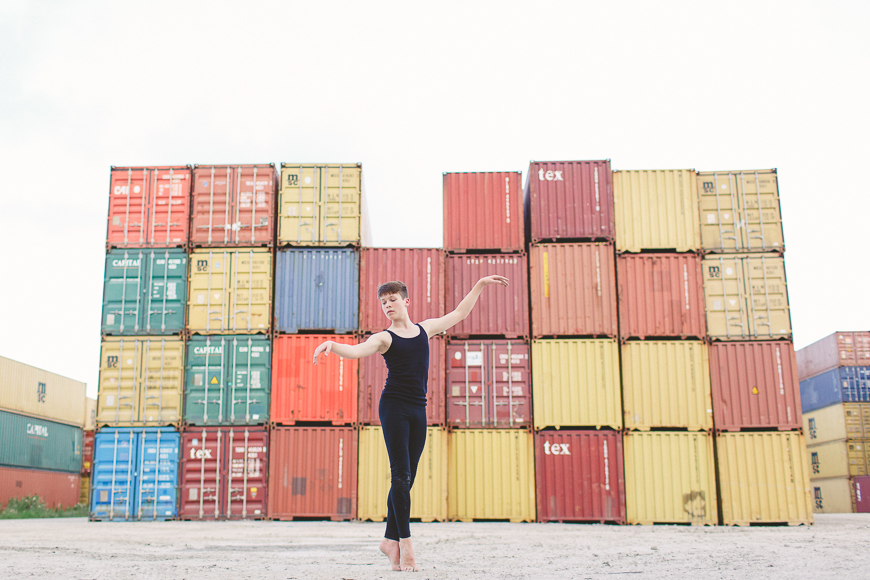 photographer allison corrin french's image of boy dancer in front of rainbow colored containers