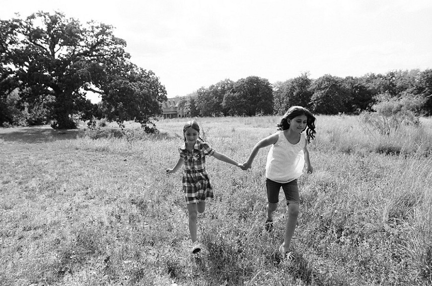 Jenny-McCann-Dallas-film-photographer's black and white image of two sisters running