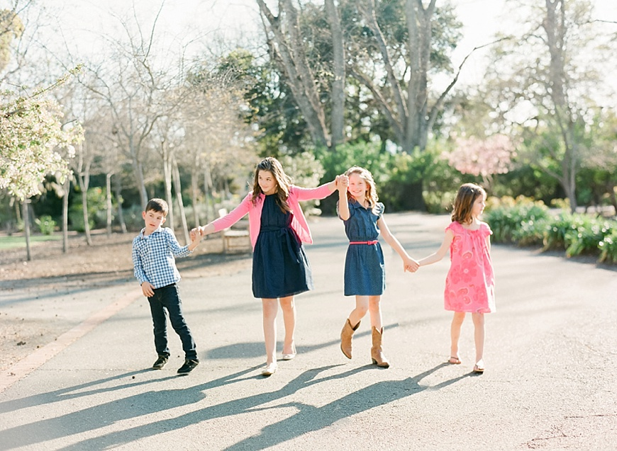 gorete ferreira photography's natural light image of four kids holding hands