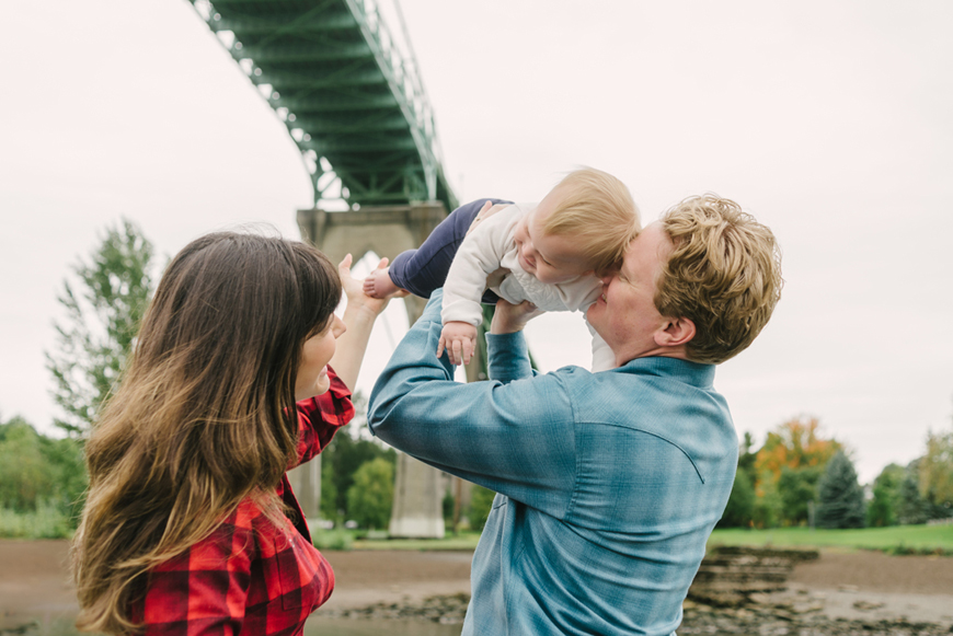 image-of-young-family-in-flannel-shirts-kissing-baby-by-portland-photographer-posy-quarterman.jpg
