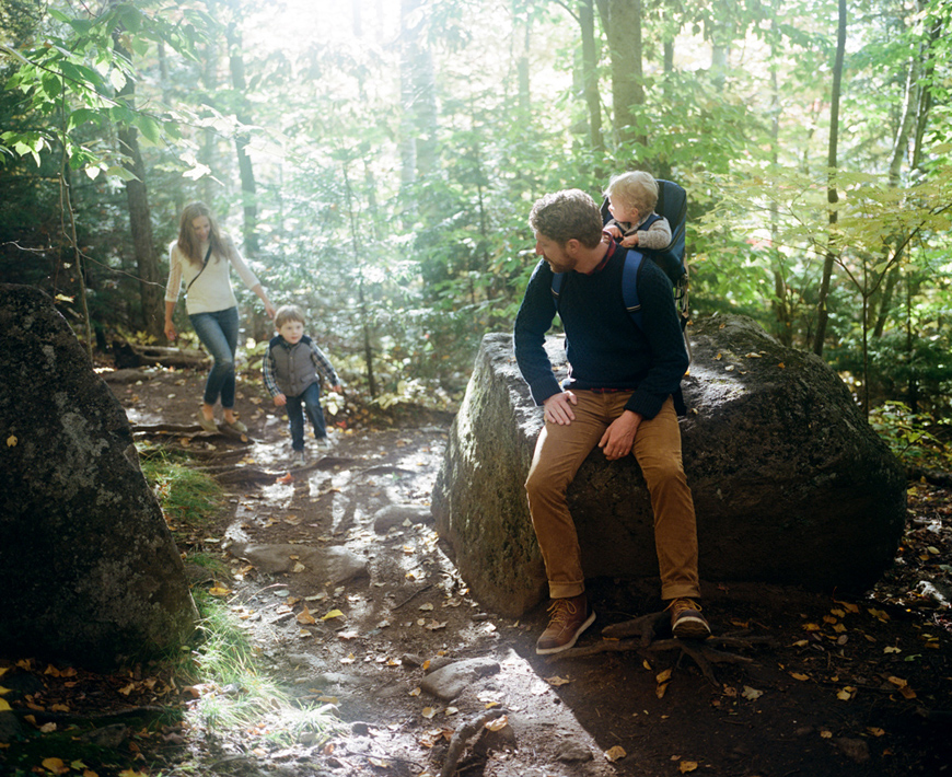 light filled shot of family hiking in woods by photographer ash imagery