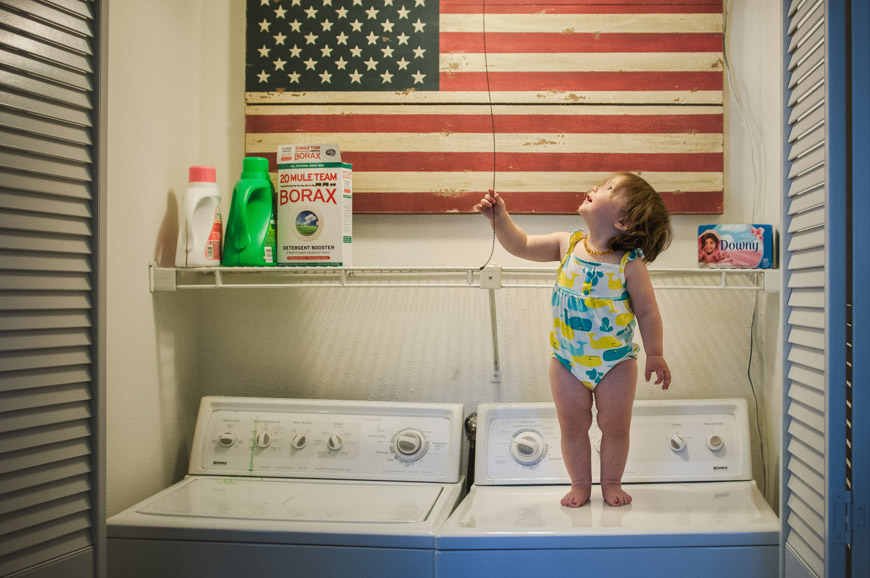 little-girl-standing-on-washer-and-dryer-picture-by-Erica-Montgomery