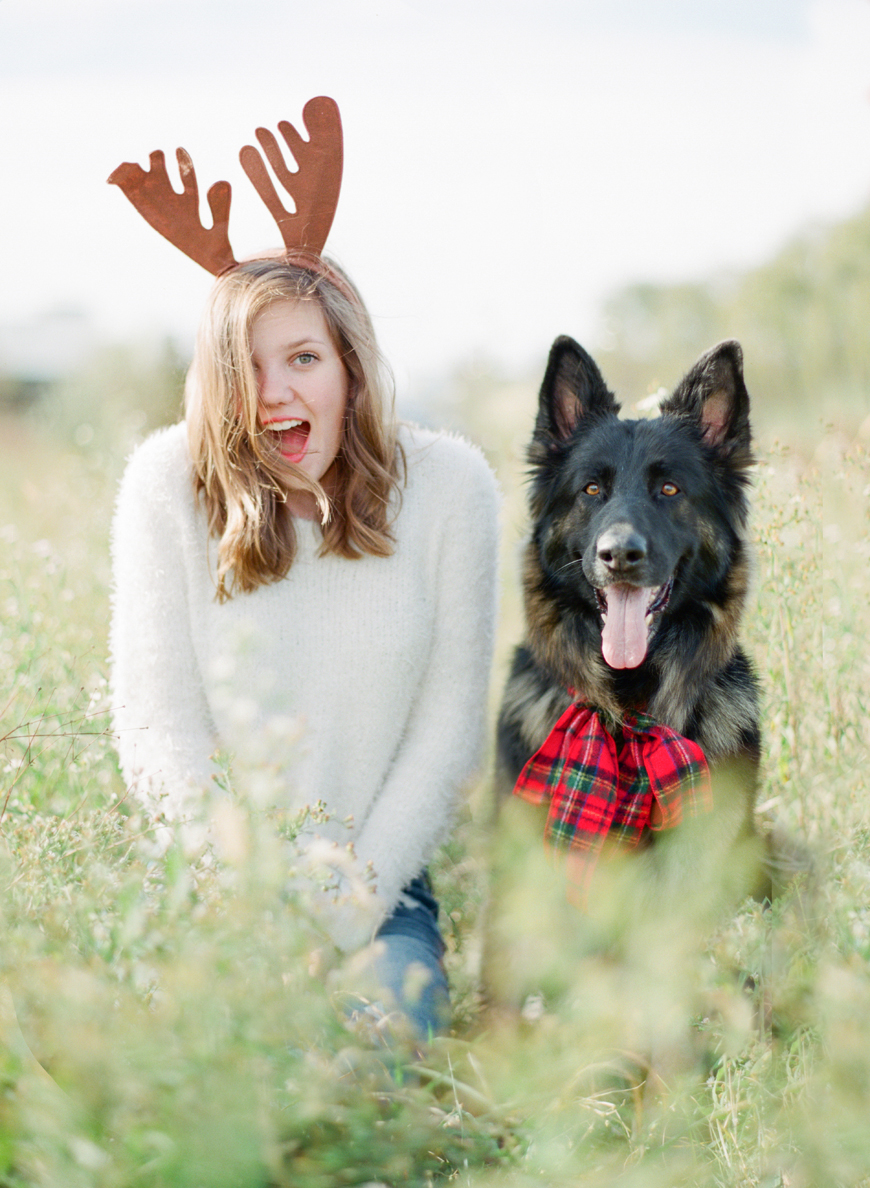marta locklear's christmas photo with daughter in reindeer antlers and black dog in christmas bow