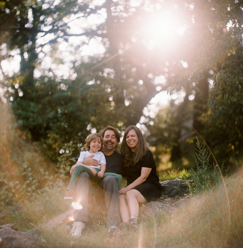 awesome image of family with sunflare on film camera by berekeley photographer zalmy b