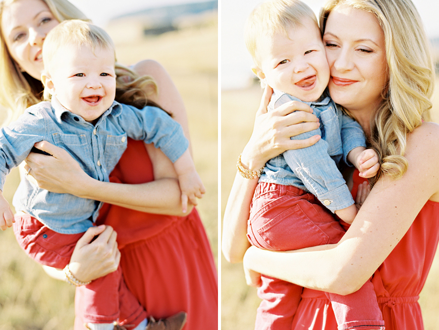 beautiful natural light in field image of mom and son in red hugging by photographer jennifer tai