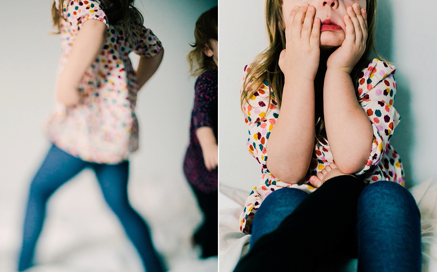 girl in colorful dotted dress image playing on bed by photographer kate de la rosa