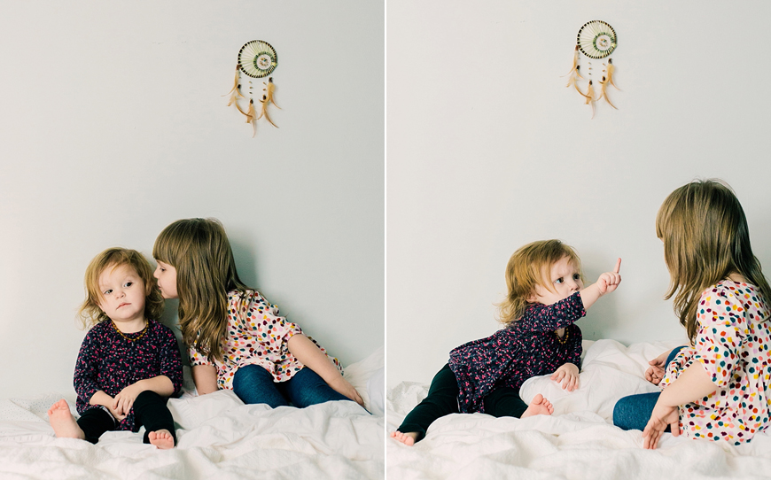 image of two sisters together against white wall