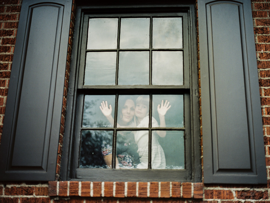 photographer brooke schultz's image of mom and daughter at window