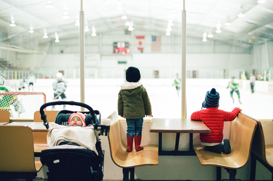 photographer erin hughes's photograph of three kids watching hockey game