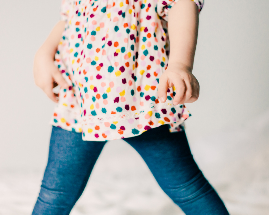 photographer kate de la rosa gorgeous photo of girl in dotted dress with blue tights