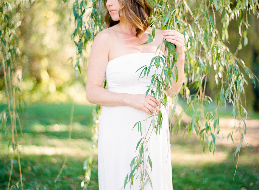 photographer mandy scaff's film image of maternity girl in white dress in hanging branches