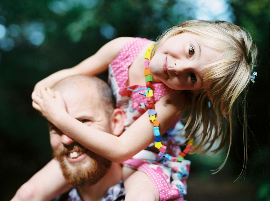 photographer molly matcham's picture of little girl in pink on dads shoulders smiling