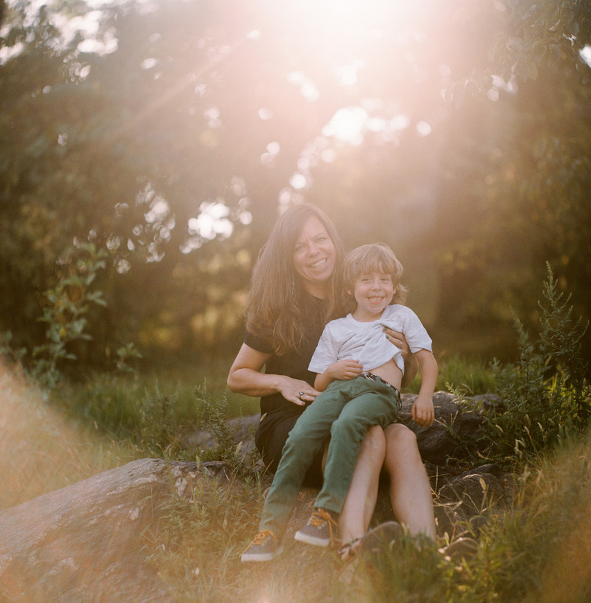 photographer zalmy b's film photograph with sunflare of mom and son