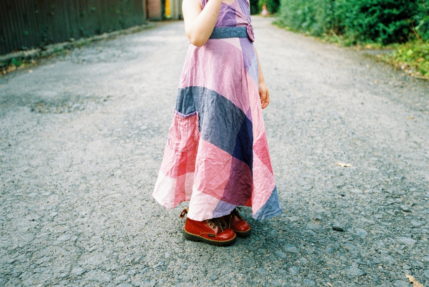 quirkly family photo of little girl in plaid dress and cute shoes by photographer molly matcham
