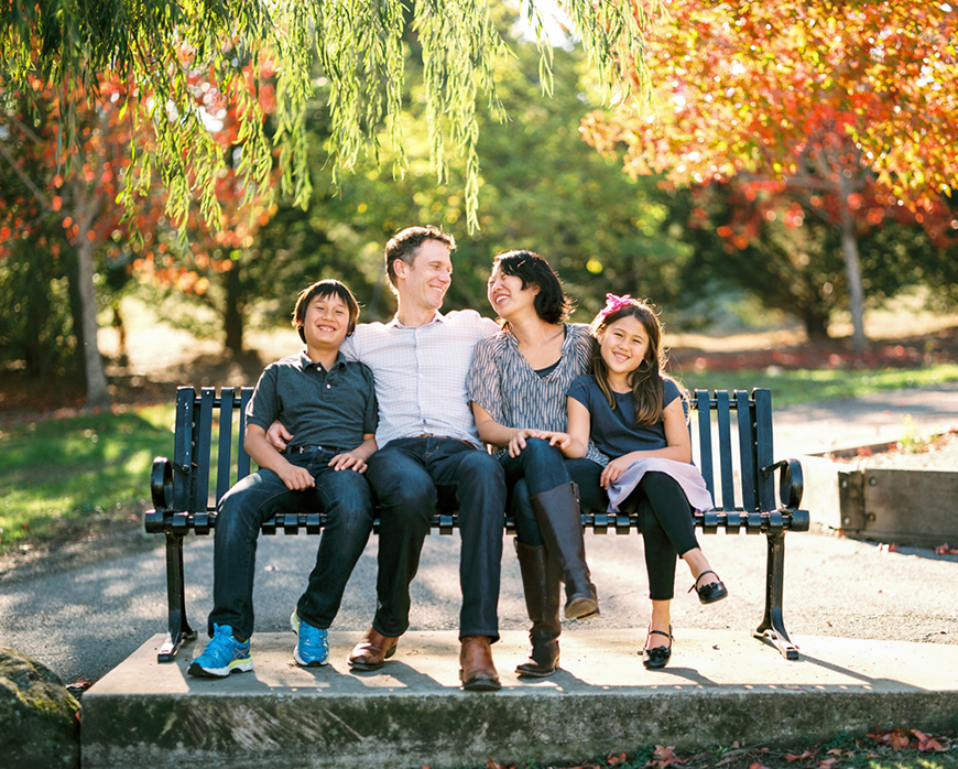 sf family photographer kimberli moffitt-tsui's image of family on bench in gorgeous natural light