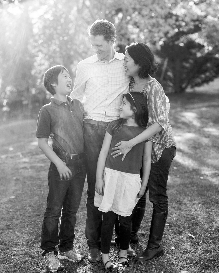 sf photographer kimberli moffitt-tsui's photo of family in black and white laughing with joy
