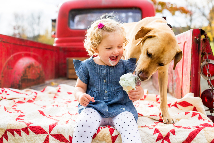 tracey buyce saratoga ny family photographer's image of little girl with icecream in red truck