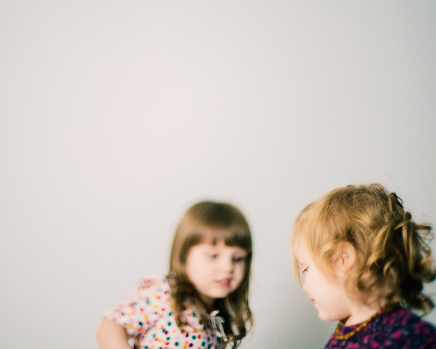 two sisters blurred photo by photographer kate de la rosa