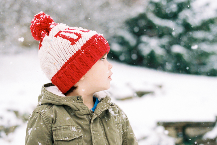 boy in red hat by snow image by photographer erin holmes