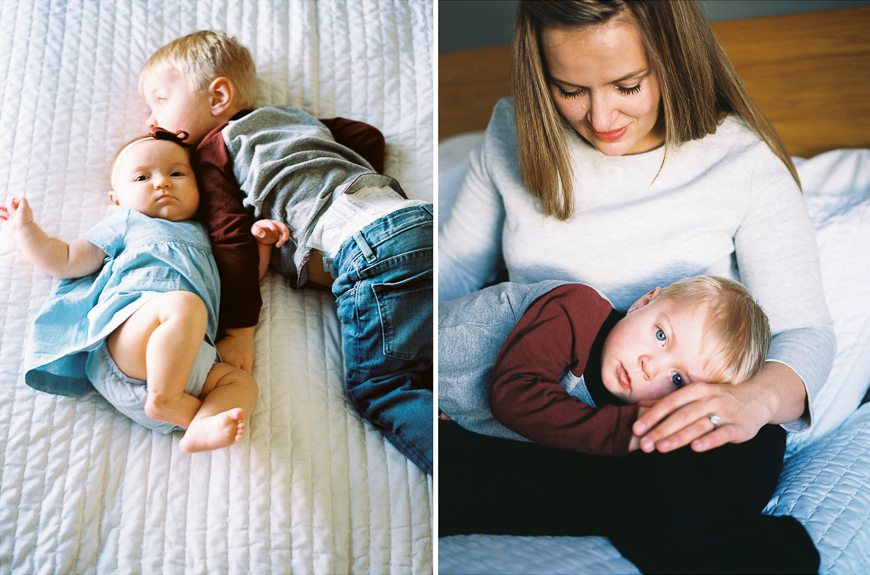 brother with baby sister on film in bed by photographer samantha kelly