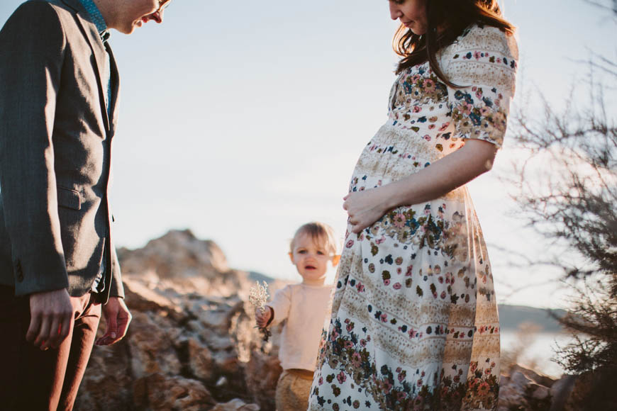 maternity image in sun glow with little girl by utah family photographer kandice breinholt