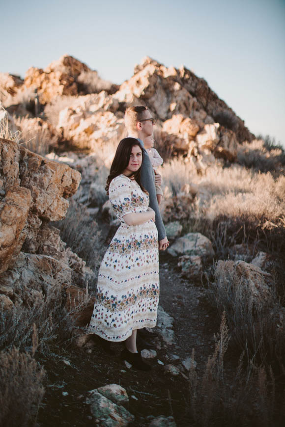 photographer kandice breinholt photography's image of family in utah with wife dressed in amazing dress