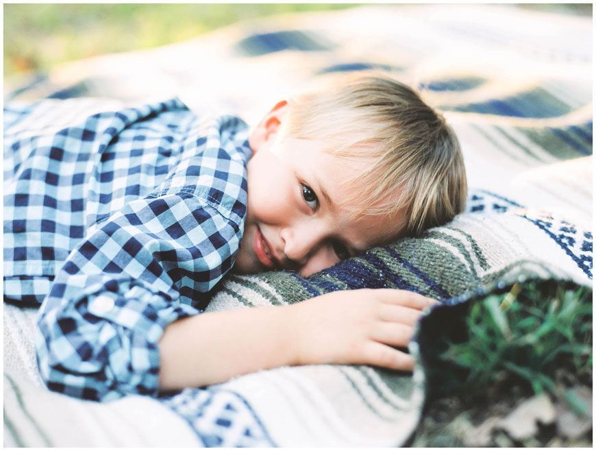 boy in blue checked shirt on mexican blanket image by cindy lee