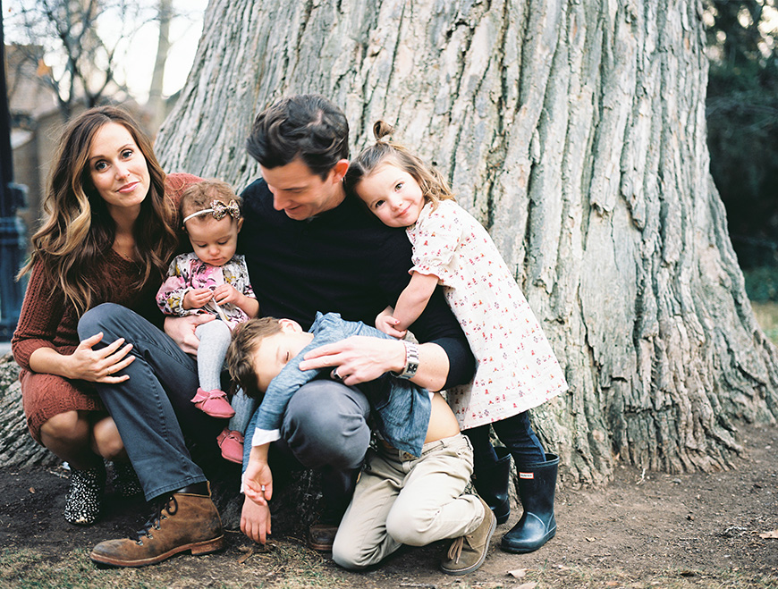 family portrait image in front of big tree in boots by utah photographer brooke schultz